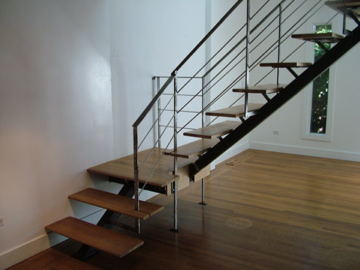Staci Southwick Floating staircase with stainless steel railing