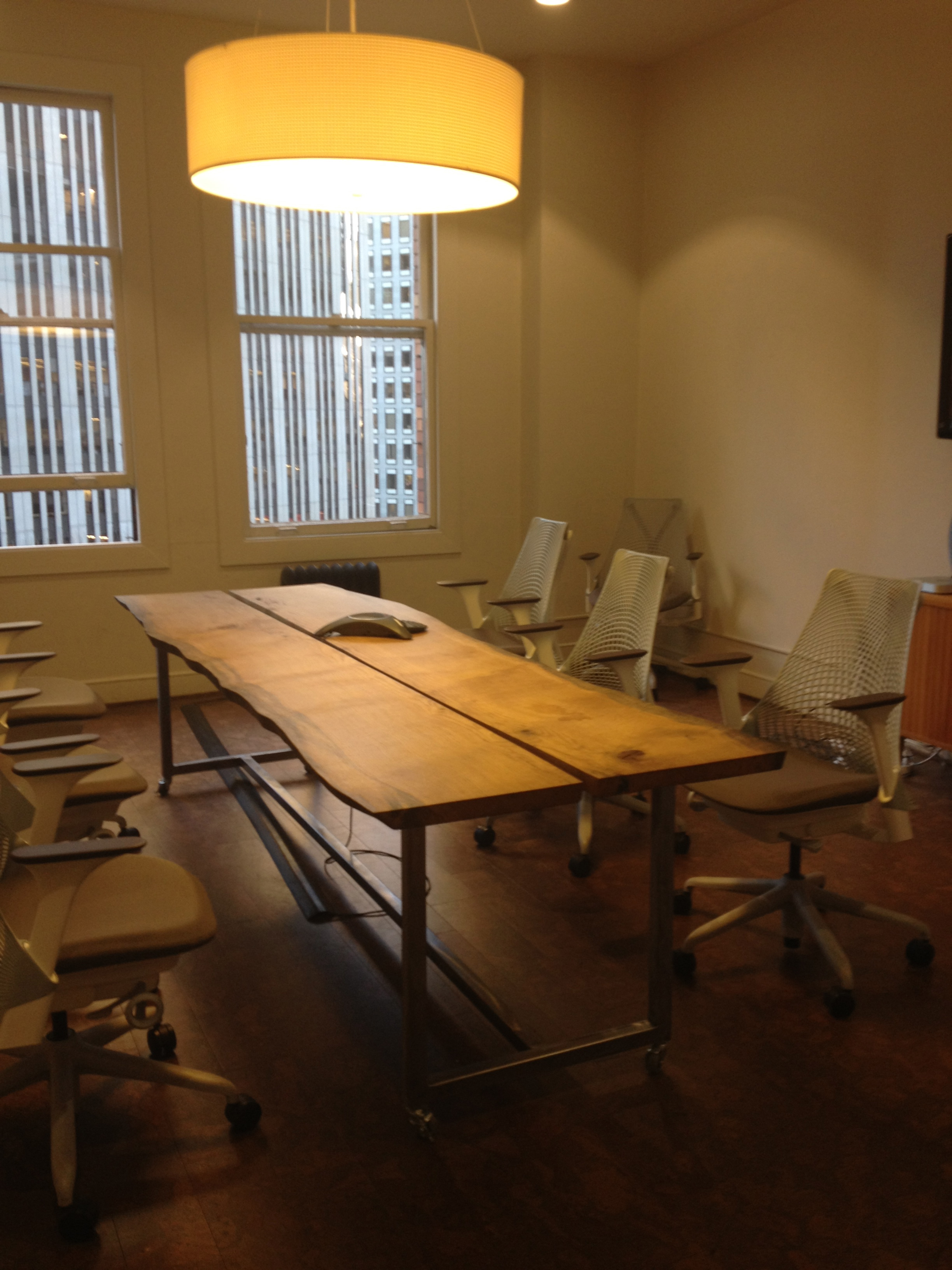 Metal base with live wood conference table.
